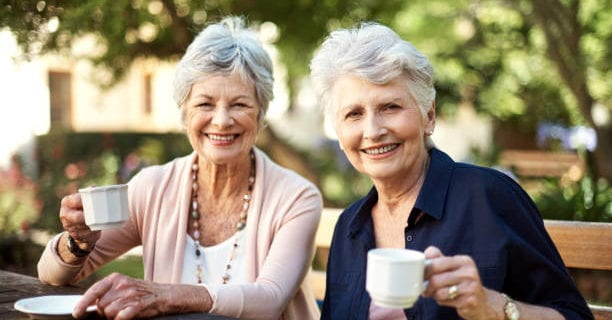 Two senior women drinking tea during the afternoon
